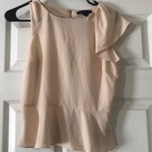 Beige blouse . Gold zipper on back